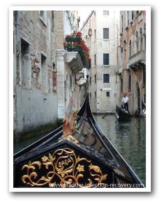 Catching a gondola down the canals of Venice, Italy